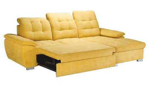 Žlutá rohová sedací souprava rozložená na lůžko